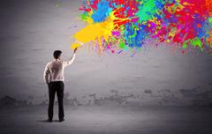 Sales person painting colorful splatter Stock Photos