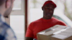 4K Delivery driver bringing package to customer's door & getting signature Stock Footage