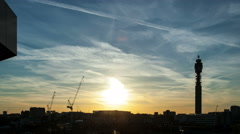 London rooftops at sunset time lapse with silhouetted BT Tower Stock Footage