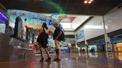Time lapse people at duty free area. Money exchange counter and tax free shop Stock Footage