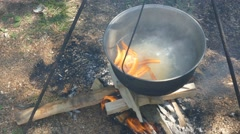 A boiling pot of water. Cooking over an open fire Stock Footage