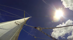 POV skywards shot of yachts sails in the sun Stock Footage