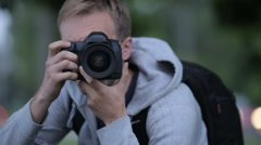 Young Man Taking Pictures At A Professional Digital SLR Camera - stock footage