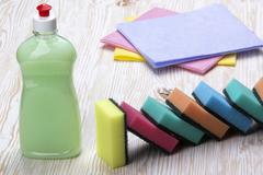 Sponges, rags and a bottle of detergent Stock Photos