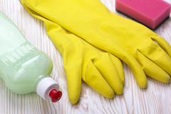 Detergent,sponge  and latex gloves - stock photo