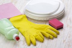 Detergent,sponge, dishes, rag and latex gloves Stock Photos