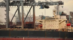 Unloading a huge ship Stock Footage