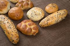 Different sorts of wholemeal breads and rolls - stock photo