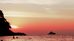 fisherman at red sunset - stock footage