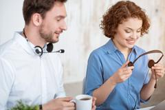 Pleasant colleagues using headset with micro Stock Photos