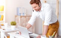 Pleasant man working in the office Stock Photos