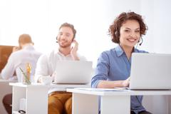 Pleasant woman working in the office - stock photo