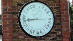 Greenwich Precision magnetic clock - stock footage