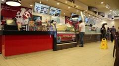 People inside fast food restaurant in Abu Dhabi, UAE Stock Footage