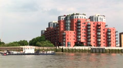 Waterfront red apartment complex Stock Footage