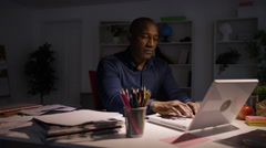 4KEntrepreneur businessman working late closing computer & finishing for the day Stock Footage