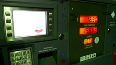 Filling up car gas tank with fuel at Chevron gas station Stock Footage