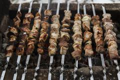 Barbecue skewers with meat Stock Photos