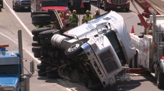 Tractor trailer truck crash on highway with police and firefighters at scene - stock footage