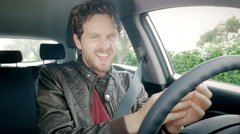 Cool man making funny moves while dancing in car slow motion Stock Footage