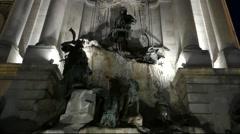 Sculptures of Hunters in the Fountain. Illumination Night Lights. Stock Footage
