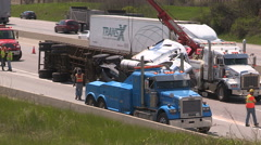 Tractor trailer truck crash on highway with police and firefighters at scene Stock Footage