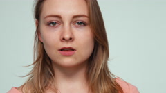 Close up portrait young adult 20 years old on white background with hatred Stock Footage