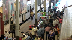 Passengers alighting from train, Colombo Railway Station, Sri Lanka Stock Footage