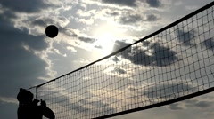 Professional Beach Volleyball at Sunset in Slow Motion. - stock footage