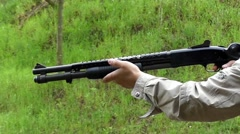 a Shot From a Shotgun in Slow Motion. - stock footage