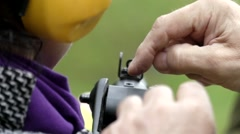 Finger Shows How to Aim and Sight. Slow Motion. - stock footage