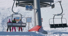 WS 4K: Girls Take of from Chair Lift Stock Footage