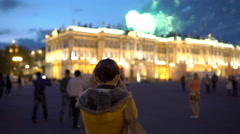 Woman taking pictures of fireworks Stock Footage
