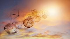 Clocks in bright sky. Time flies - stock photo