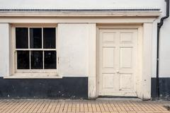 Empty white painted wooden door with a blacked out window frame. Copy space a Stock Photos