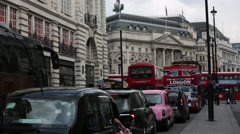 Piccadilly Circus: red busses, London, England Stock Footage