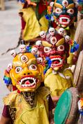 Monks perform a religious masked mystery dance of Tibetan Buddhism Stock Photos