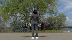 Girl in Opening Umbrellas in Slow Motion. She Standing in Sport Suit. Stock Footage