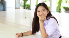 Portrait of thai student High School beautiful girl relax and smile Stock Footage