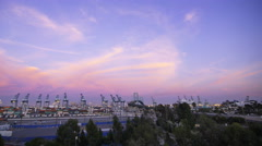 Time Lapse of Colorful Sunset Afterglow at Port of LA at Twilight -Pan Left- Stock Footage