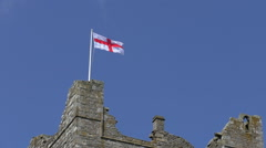 Flag of England above old castle Stock Footage