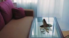 White Brides Shoes at Glass Table Stock Footage
