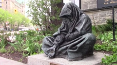 Statue of a beggar in front of a church - stock footage