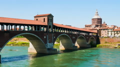 Pavia old covered bridge over Ticino River Hyperlapse, Italy Stock Footage