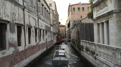 Water taxi reversing along Venice canal Stock Footage