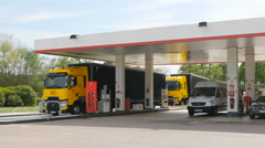 Renault Formula One truck at gas station Stock Footage