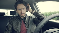 Handsome man in car adjusting hair serious slow motion Stock Footage