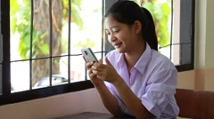 Portrait of thai student High School beautiful girl using her smart phone. Stock Footage