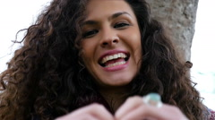 Portrait of happy young woman making love heart gesture with hands, slow motion - stock footage