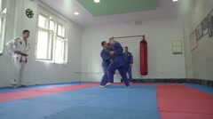 Self defense from the knife,athletes practicing martial arts by Pakito. Stock Footage